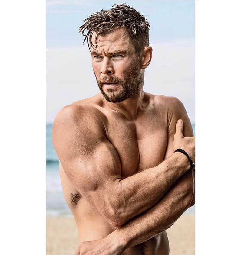 Chris Hemsworth Tight Taper Undercut and Long Messy Top Hairstyle