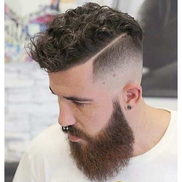 Disconnected Undercut Hairstyle with Messy Curly Top and Hard Part
