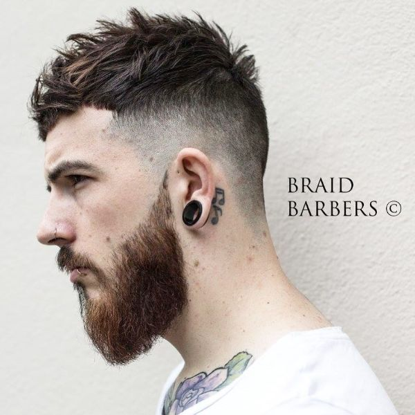 High Fade Cut with Textured Top Hairstyle