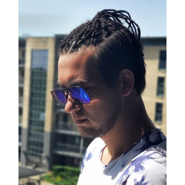 High Taper Haircut with Box Braids Top Knot