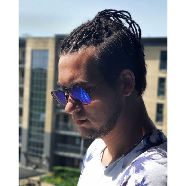 High Taper Haircut with Box Braids Men Top Knot