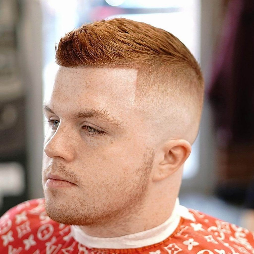redhead man with short on sides long on top haircut