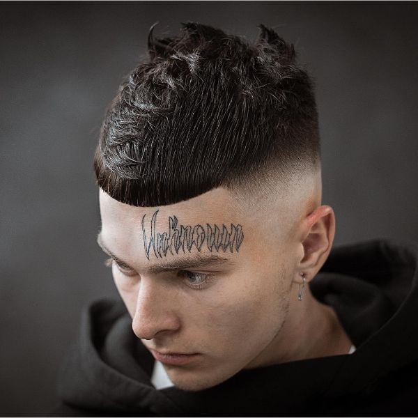 High and Tight Short Hairstyle with Messed-up Top