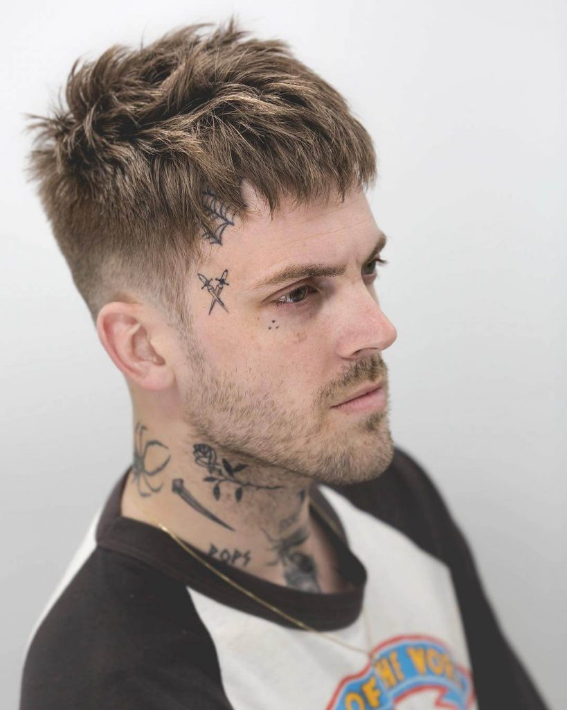Jagged Piecey Textured Top with Low Taper Fade Undercut