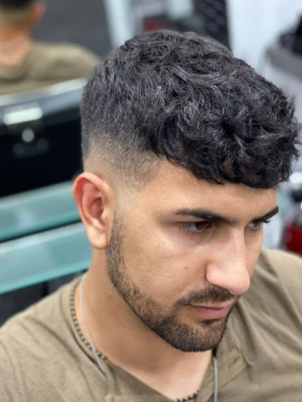 Low Fade with Curly Messy Top