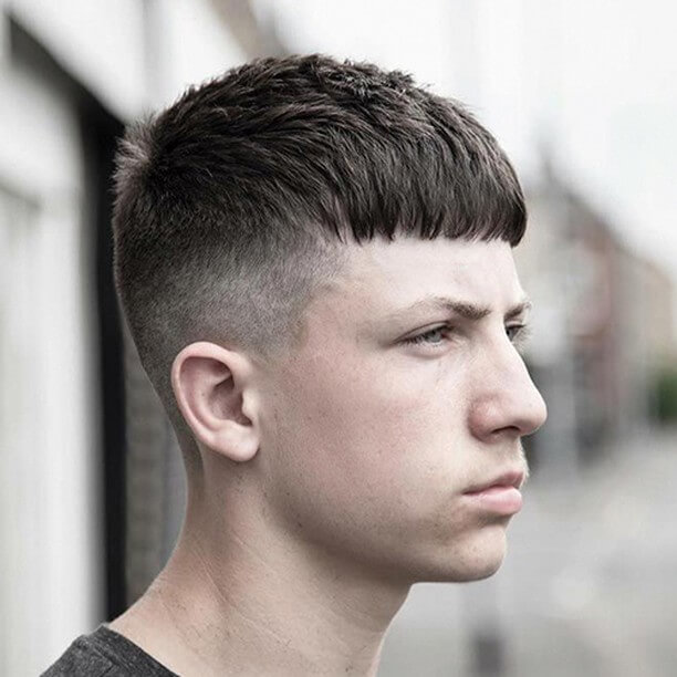 Medium-length Bangs and Taper Fade Haircut