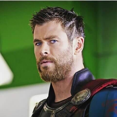 Short Textured Chris Hemsworth Thor Ragnarok Haircut with Shaved Design