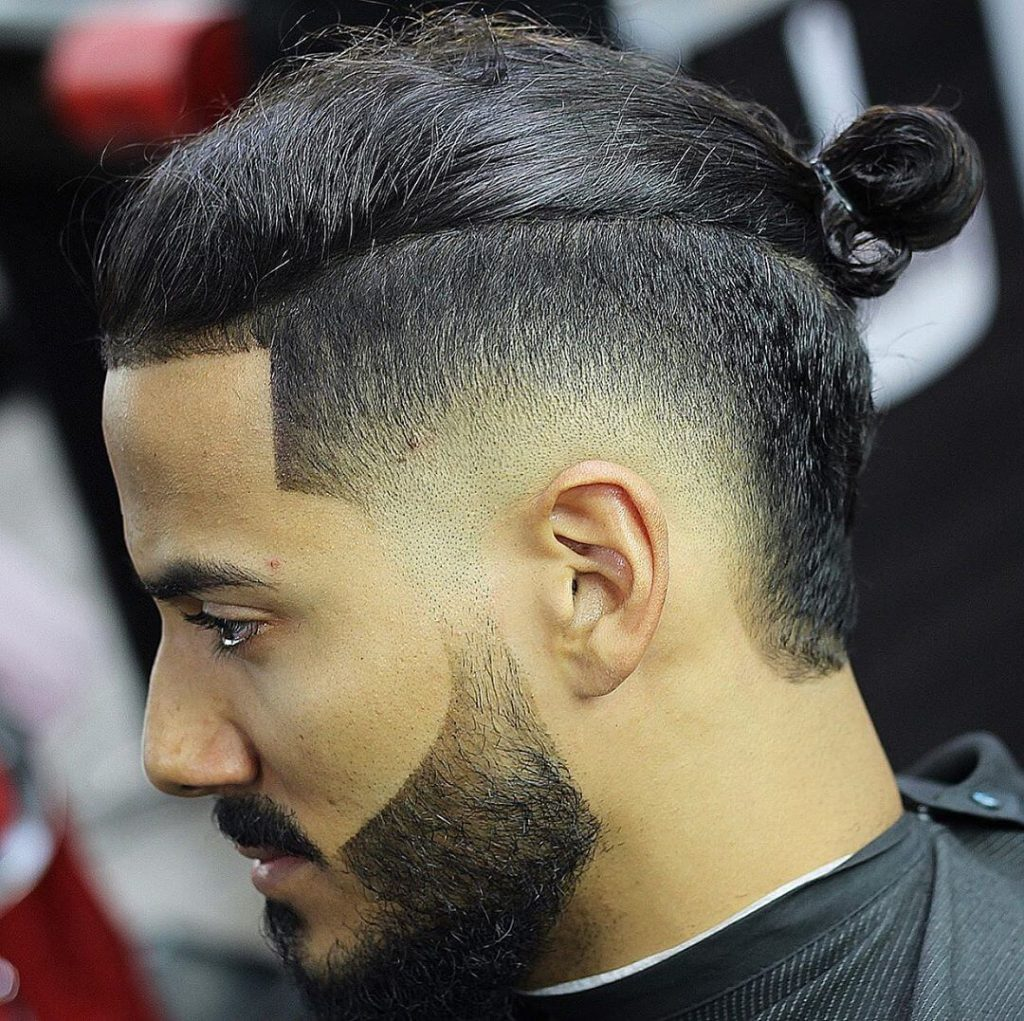 man with short on sides long on top and knotted hairstyle