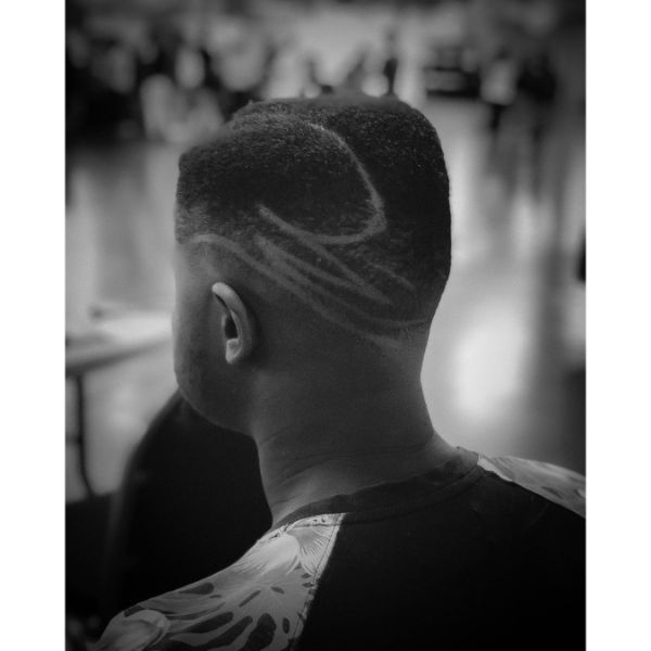Short Juice Box Fade Cut with artistic design in the back
