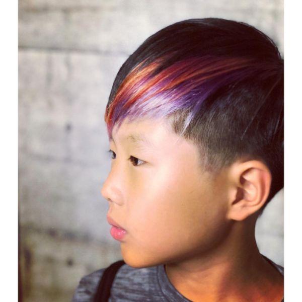 Boys Fade Haircut with Multicolored Bangs and Nape Fade