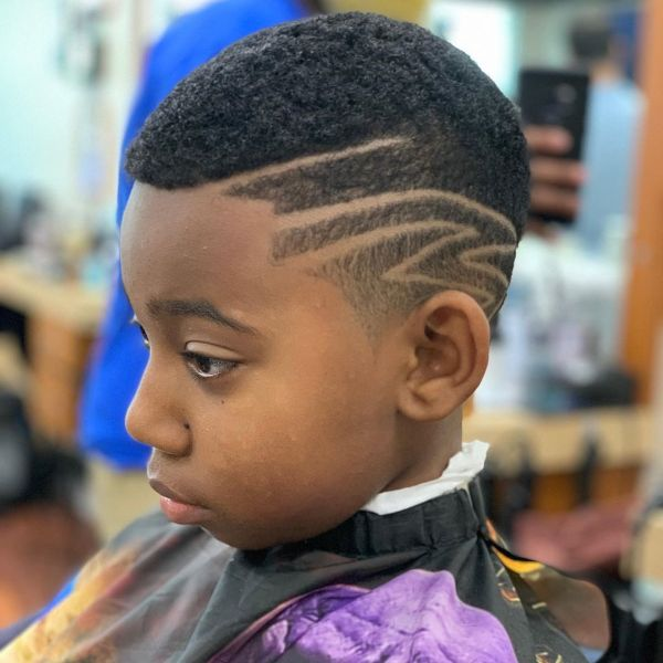 Buzz Cut with Artistic Side Design for Curly Hair