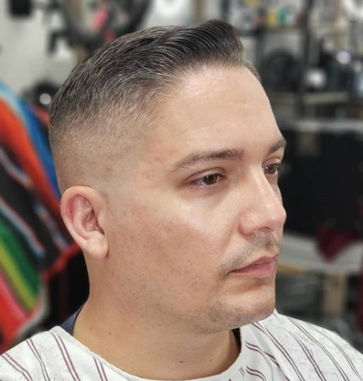 Classic Taper Cut with Subtle Pompadour Hairstyle for Older Men