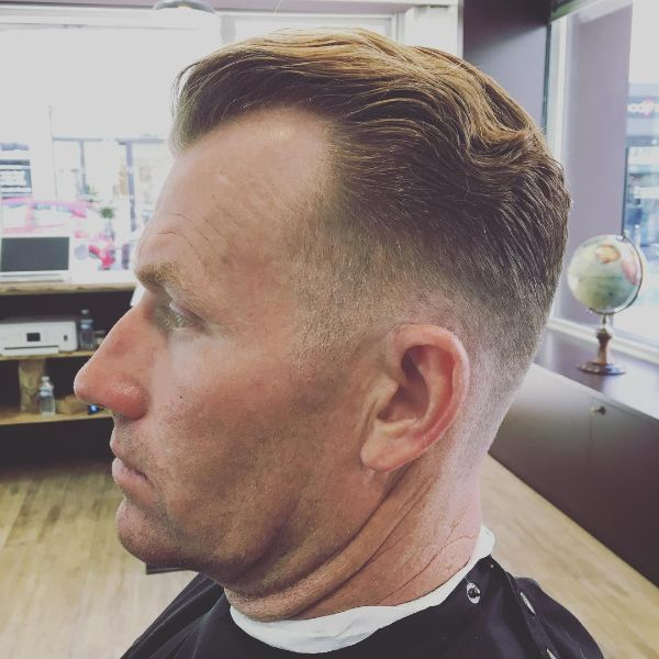 Fade Haircut with Wavy Top for Older Men