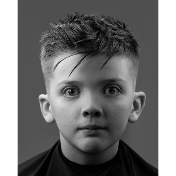 High Fade Boys Haircut with Uneven Bangs and Messy Top