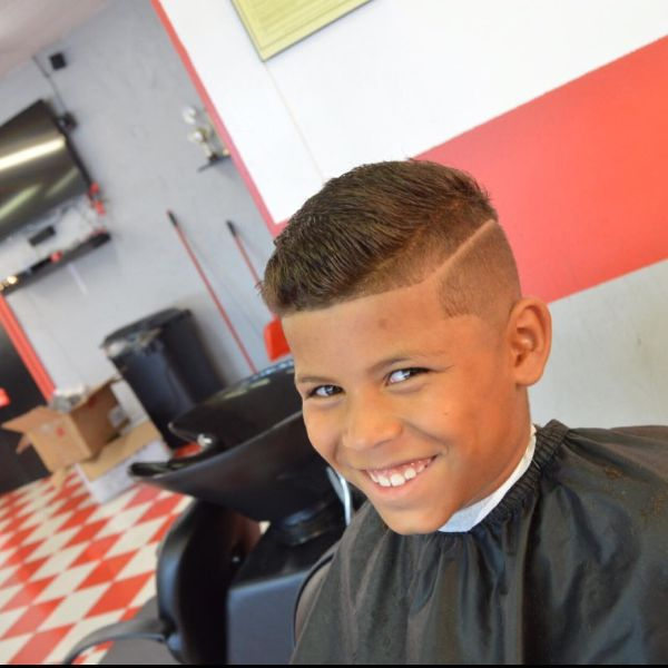 High Fade Haircut with Long Top and Side Razor Pattern