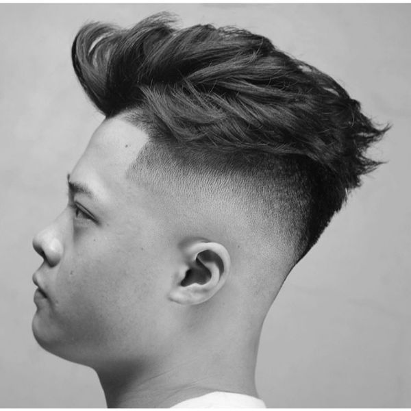 High Fade Haircut with Messy Layered Top