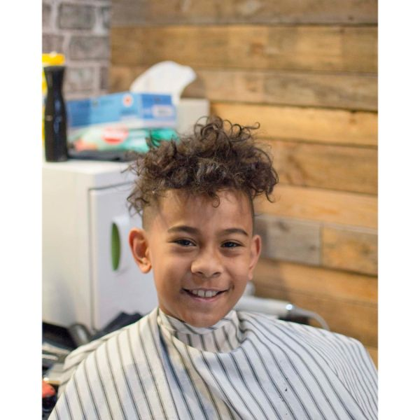 High and Tight Boys Haircut with Messy Curly Top