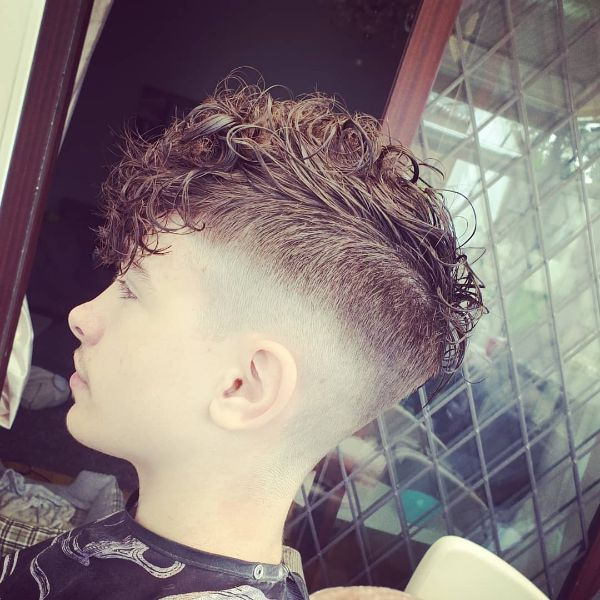 High and Tight Fade Cut with Faux Mohawk for Curly Hair