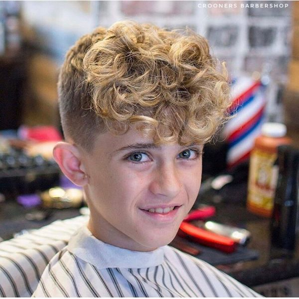 High and Tight Skin Fade with Extra Long Curly Top