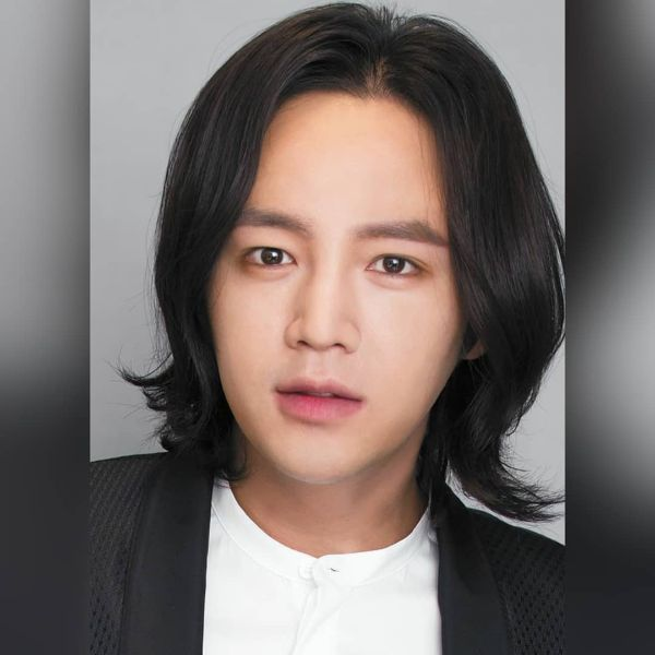 Medium-Long Haircut with Middle Part for Korean Men