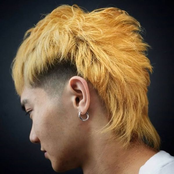 Shag Haircut with Yellow Colored Faux Mohawk and Shaved Side for Korean Men