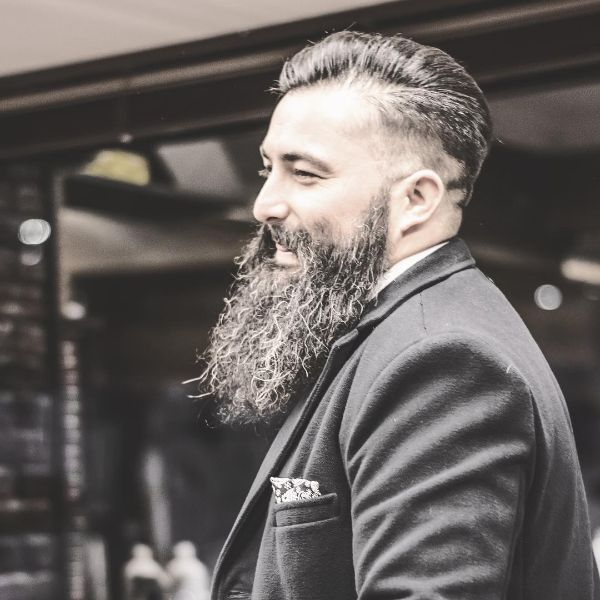 Swept Back Executive Hairstyle with Extra-Long Beard