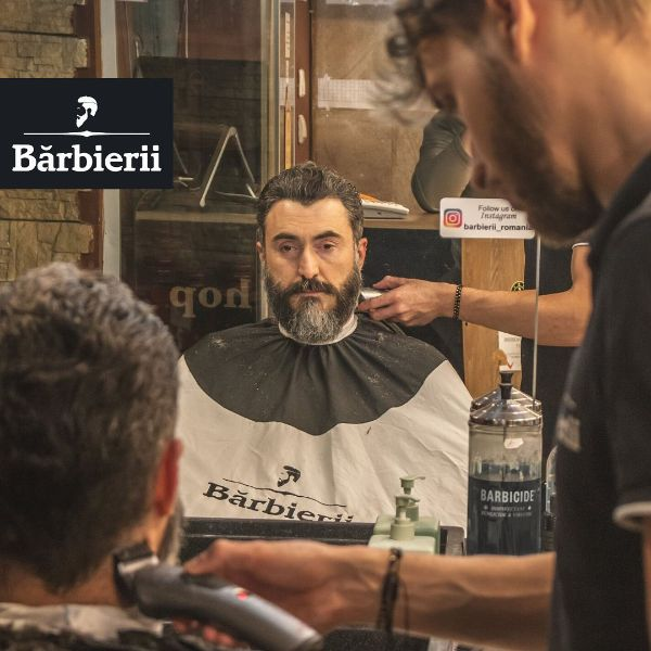 Swept-back Black and Grey Hairstyle for Older Men with Beard