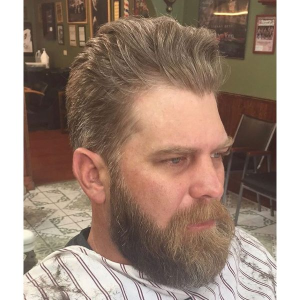 Voluminous Taper Haircut for Wavy Hair with Beard