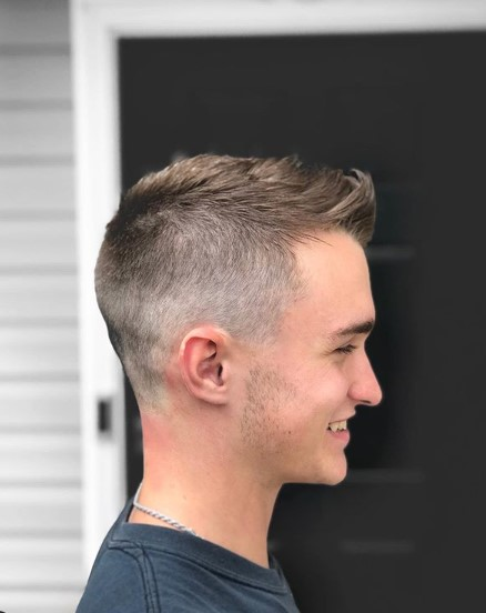 Fade Cut with Side Part Hairstyle for Teenage Guys