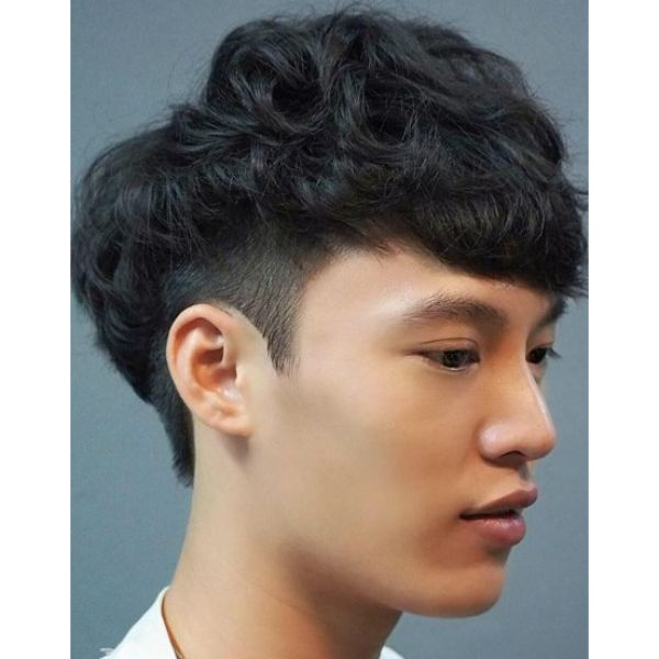 Low Fade with Wavy Long Top and Bangs