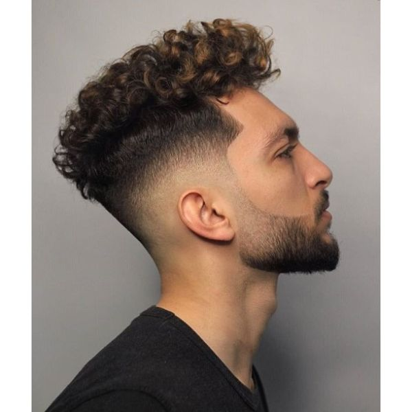 Mid Fade with Curly Balayage Top Short Sides Long Top Hairstyles