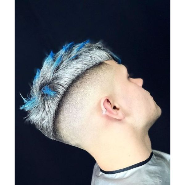 Sharp Fade with Platinum Blonde Top and Blue Highligts