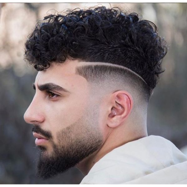 Skin Fade with Hard Part and Curly Top