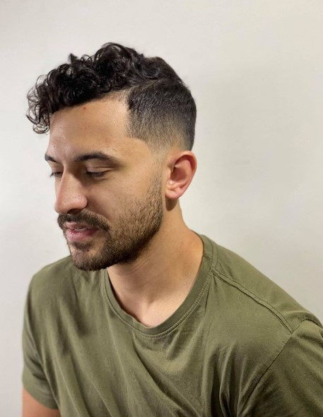 Taper Fade with Soft Part and Curly Top