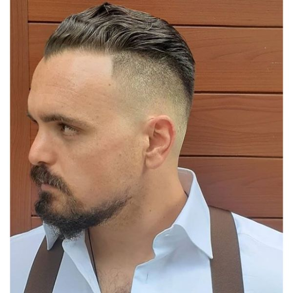 Tight Skin Fade on the sides with traditional slick back on top
