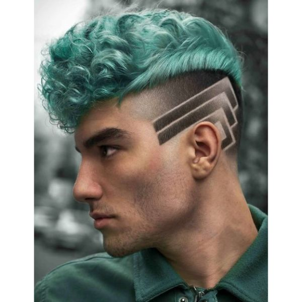 Turquoise Curly Skin Fade with Razor Design Short Sides Long Top Hairstyle