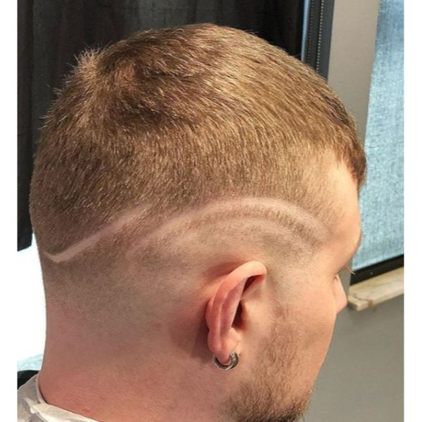 Buzz Cut with Mid Fade and Curved Razor Design