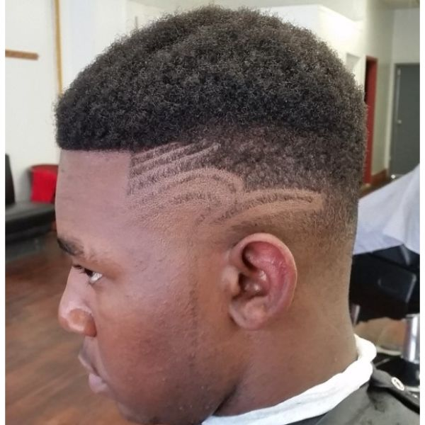 Curly Top High Fade with Side Razor Design