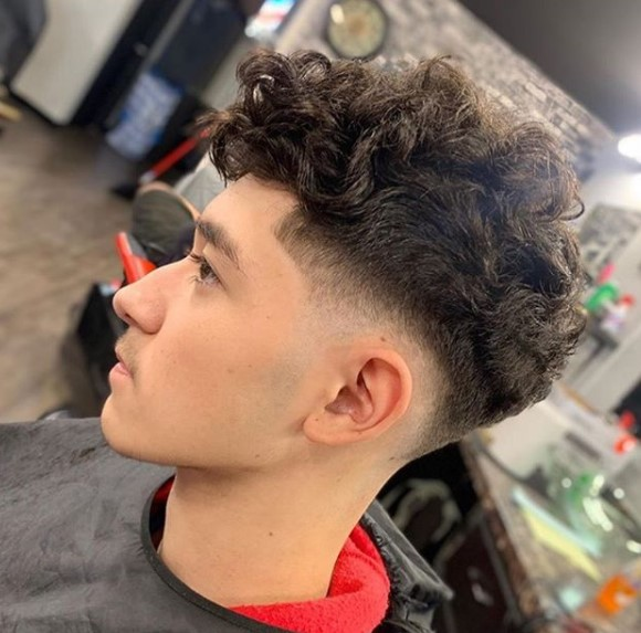 Curly Top medium length hairstyles for men