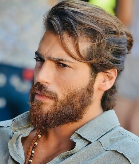 Medium length hairstyles for men Top Knot with Falling Strands