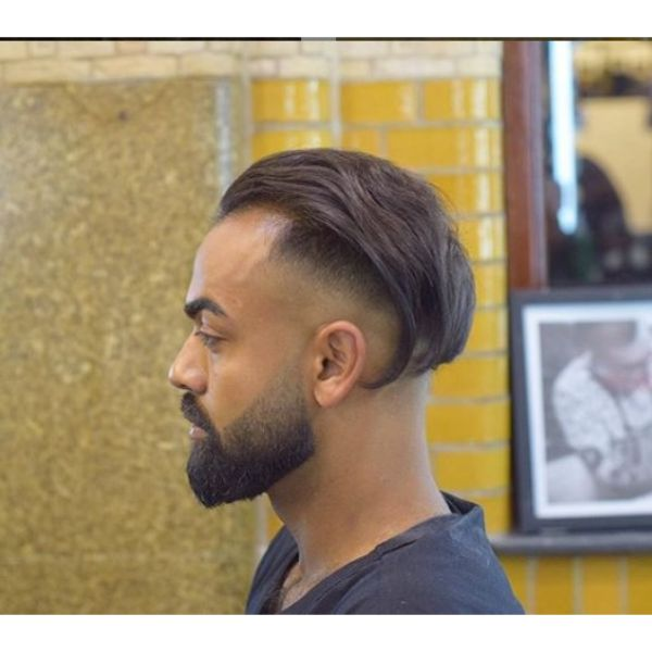 Mid Fade Undercut with Slicked Back Top Hairstyle For Men