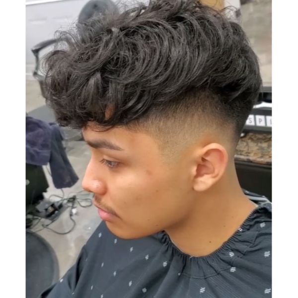Shaggy Curly Undercut Hairstyles For Men