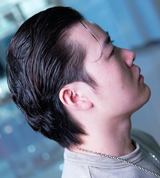 Slicked Back Flow medium length hairstyles for men