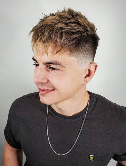 Spiky Blonde Undercut with Dark Roots Hairstyles For Men