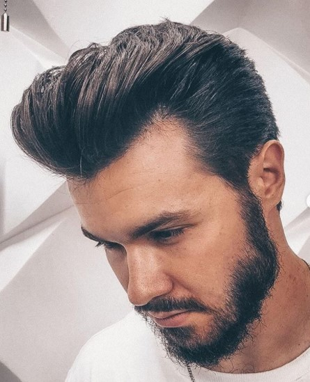 Swept-up Classic Pompadour medium length hairstyles for men