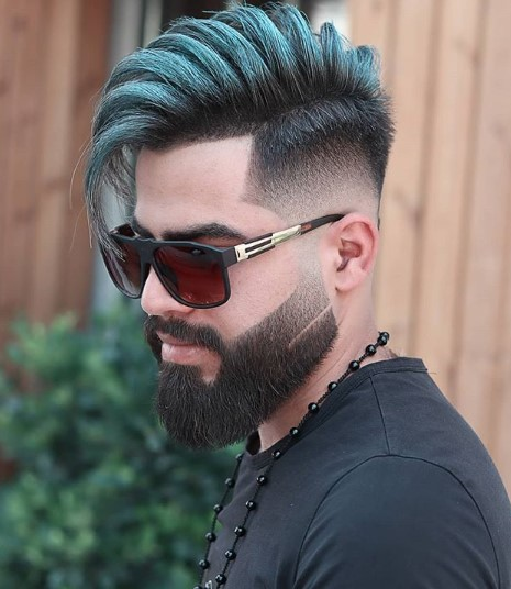 Teal Colored Long Undercut with Falling Strands