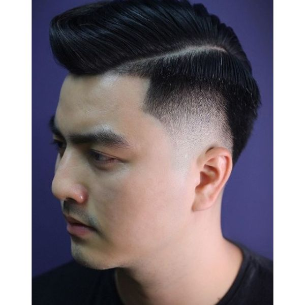 Undercut with Side Part and Pomp Top Hairstyle For Men