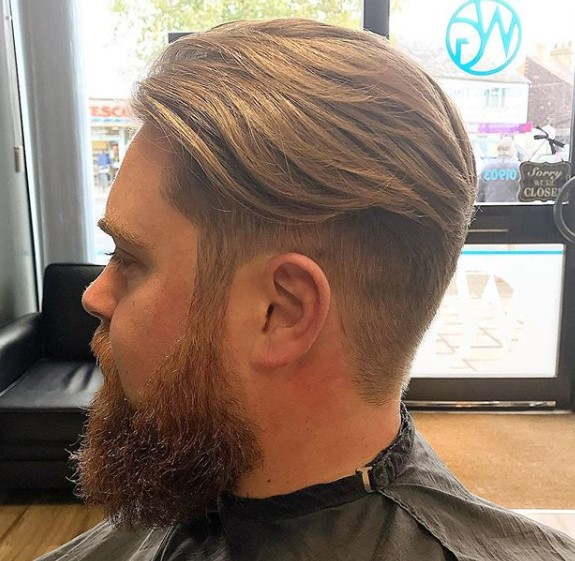 Warm Blonde Colored Undercut with Wavy Top