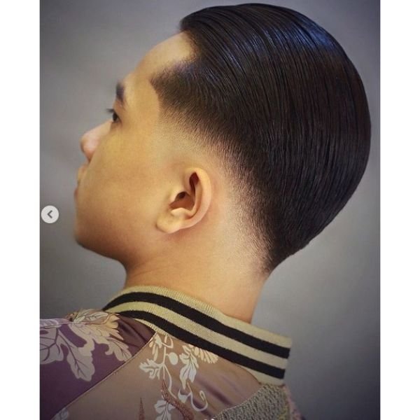 Wet Slicked Back Style With Low Fade