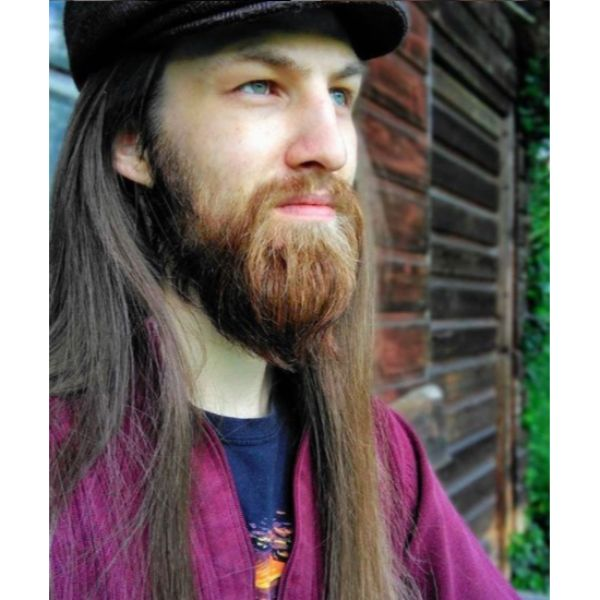 Long Feathered Viking Hairstyle with Small Beard